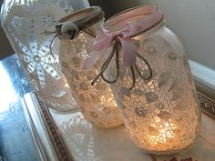 For a romantic glow, cover your Mason jar lanterns in lace and soft pink ribbons.    Photo courtesy Crafts By Amanda.   # Pinterest++ for iPad #