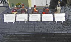 A Bourbon bar, displayed on the Slate Patio outside the Boxwood Gardens for an after-ceremony cocktail. Luxury Inn, Slate Patio, Bourbon Bar, Boxwood Garden, Brick Pathway, Willow Grove, The Slate, Giant Tree, Timeless Elegance