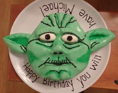 First attempt at working with fondant - I made the marshmallow kind, it taste better. I am not really proud of this cake, but it will allow me to see my progress as I hopefully get better. :) (It was supposed to be Yoda)