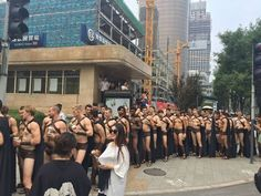 Dozens, if not hundreds, of cute half-naked guys in Spartan costumes showed up in downtown Beijing on Wednesday. | This Is What Happened When Hot Male Models Walked Around China In Spartan Costumes