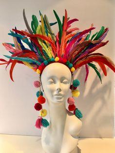 A personal favorite from my Etsy shop https://www.etsy.com/listing/495635798/pom-pom-headpiece-feather-headdress