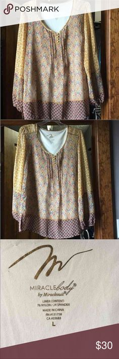 MiracleBody Top Miracle Body Top, built in shaper. Look 10 lbs lighter instantly! Perfect for Fall weather. Excellent condition. Miraclesuit Tops Blouses