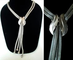 Silver Mesh Mid Century Lariat Necklace 1960s 1970s Statement by looseendsvintage on Etsy https://www.etsy.com/listing/494674820/silver-mesh-mid-century-lariat-necklace