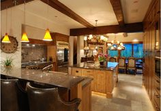 Luxurious kitchen design with breakfast bar and pendant lights