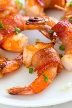 How to Make the Best Bacon Wrapped Shrimp // These bacon wrapped shrimp are addictive and have the most delicious and easy spicy glaze made with maple syrup and Sriracha chili sauce. Whole30 Shrimp Recipes, Easy Bacon Recipes, Seafood Recipes, Cooking Recipes, Seafood Dishes, Shellfish Recipes, What's Cooking, Keto Recipes, Tapas