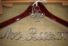 I want my dress hanging on a hanger with my new last name on it on my wedding day :)