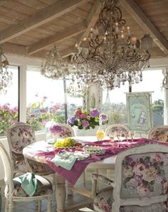 gorgeous dining porch - what a chandelier