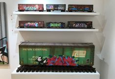 Model trains covered with graffiti by artist Tim Conlon.