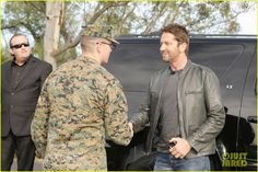Gerard Butler Accepts Invite to Marine Corps Ball (Video): Photo #3590496. Gerard Butler puts his fists up while posing with marines at Camp Pendleton on Friday afternoon (February 26) in San Diego, Calif. The 46-year-old actor visited…