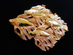 Items similar to JJ Jonette Shiny Gold Tone Shoal Of Angelfish Brooch Pin on Etsy