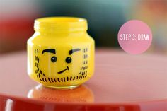 DIY LEGO Pencil Holder. Absolutely love this idea! All you need is a baby food jar, yellow acrylic paint and a sharpie permanent marker.