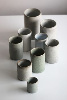 Florian Gadsby   A selection of thrown cylinders, with a selection of crackle, chun and celadon glazes.