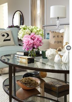 Source Jillian Harris Pastel Living Room With Oval Gl Top Tail Table Blue Accent Chair Linen Slipcover Sofa And Vintage Grain Sack Pillows