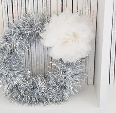 Great idea for Christmas wreath.  http://www.creaturecomfortsblog.com/home/2010/11/16/diy-5-minute-tinsel-garland-wreath.html#