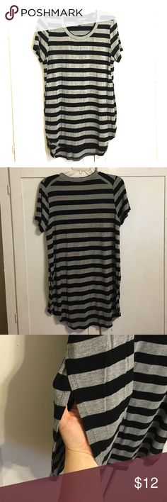 Perfect Black and Grey Striped Cutaway Top Great piece for layering. Super soft and cozy. Cutouts along sides. Well loved and cared for with price accounting wear. Thanks for looking! Tops
