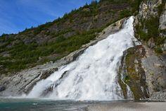 Nugget Falls at Mendenhall Glacier Recreation Area cascades 377 feet (115 m) onto a sandbar in Mendenhall Lake. The walk to the base of the falls will take you about 20 minutes each way. #Mendenhall #Glacier #NuggetFalls #Juneau #Alaska #Waterfall