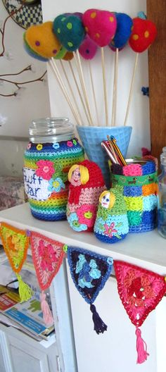 Crochet | planetpenny.co.uk - Part 6. I like the people and the triangles. the cosies are cute, too!