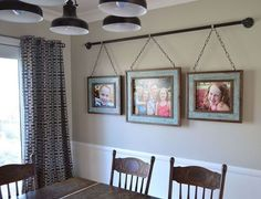 This isn't your grandma's picture rail! We love seeing these pictures hung in a Victorian style with a modern twist using large-link chains and an iron pipe. iron pipe family photo display, dining room ideas, home decor, repurposing upcycling, wall decor Photowall Ideas, Display Family Photos, Family Photos On Wall, Blended Family Pictures, Unique Family Photos, Unique Picture Frames, Display Pictures, Display Ideas, Diy Casa
