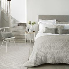 The White Company US. Madison Collection | Cushions, Bedspreads & Throws | Made from the softest 100% cotton on both the front and reverse, our Madison has been expertly hand-quilted with 3cm wide channel design. Soft and cosy to touch, layer into your bed to add texture on top of simple bed linen. Perfect for a more modern relaxed look.Pinning from the UK? -> http://www.thewhitecompany.com/bedroom/cushions-bedspreads-and-throws/madison-collection--silver-grey/