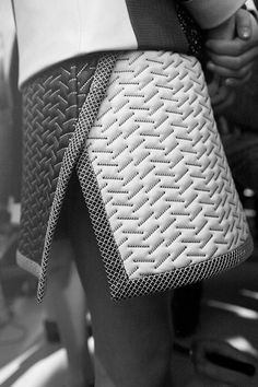 Quilted skirt with graphic stitched patterns & contrasting panels; sewing; geometric fashion detail // Proenza Schouler