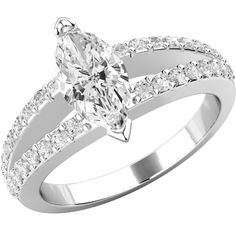 A stunning split band Marquise Cut diamond ring with shoulder stones in 18 ct. white gold