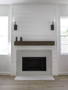 Wire electric for sconces. Shiplap fireplace with quartz by Studio Matsalla