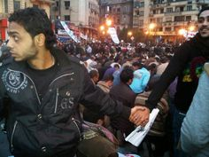 Christians protect Muslims during prayer in the midst of riots in 2011 in Cairo, Egypt.
