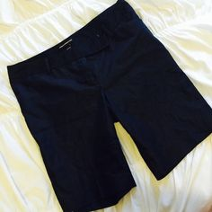 Express Editor Design Studio Bermuda Short Beautiful dark blue jean look with a gorgeous dressy sheen over top! Very sophisticated and figure flattering Bermuda cut! Worn once but button on back pocket is cracked in half which is why I'm selling at price listed :) Express Shorts