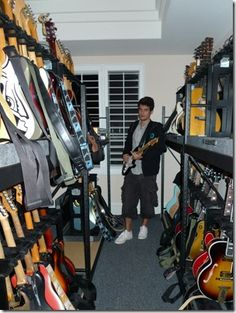 John Mayers Guitar Collection. I wish I had enough guitars to fill a room.