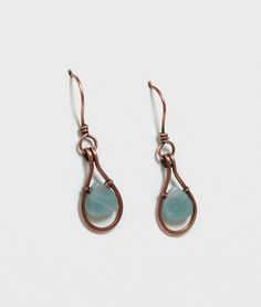 Hand crafted copper wire framed dangle earrings with Amazonite teardrop accents.  The dangle earring frame was made specifically for the lovely Amazonite teardrop stone accents.  The copper wire is ha