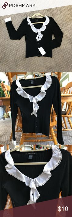 Black Blouse with White Eyelet Collar and Cuffs EUC Black and White button down work Blouse by August Silk Knits. Size medium and fits true to size with a bit of stretch. Comfortably soft material that breathes. Small stitch pulled on the right arm that's barely visible. Business casual, best worn with dress slacks and heels. august silk Tops Blouses
