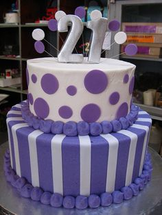 2-tier Wicked Chocolate cake iced in purple & white butter icing decorated with white fondant stripes, purple polka dots & 3D silver #21 by Charly's Bakery. I want this one for my 21st!! Mom! Check this out!!!!