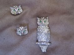 http://www.ebay.com/itm/Estate-Sterling-Silver-Owl-Brooch-Pin-Earring-Set-Rhinestones-Integrity-/311453880586?hash=item488419110a