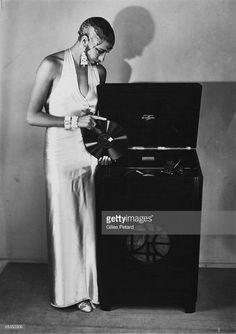 Photo of Josephine BAKER; Posed studio full length portrait of Josephine Baker, record player Get premium, high resolution news photos at Getty Images Josephine Baker, Belle Epoque, Burlesque, Missouri, Divas, Paris, Vintage Black Glamour, Harlem Renaissance, Jazz Age