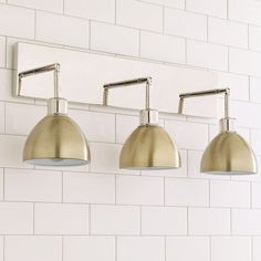 This Young House Love super functional Dapper Bath Light has 3 adjustable arms which can be adjusted up and down or side to side. Perfect for mounting over your favorite bathroom mirror or it could even be pointed down and mounted on the ceiling over a kitchen island! Available with a Dark Bronze or Chrome backplate with fun shade combinations of White, Bronze, Brass or Chrome. 3 x 40 watt max, medium base sockets. For even brighter lighting, try using one of our LED replacement bulbs…