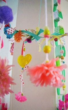 DIY mobile great for decorating a little girls room and with the right items, a little boys room