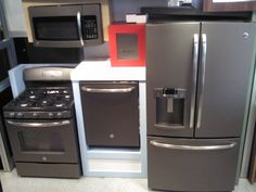 This is a kitchen 4 piece set of GE Slate colored appliances. GE sent us the display that the appliances are in to show off how versatile the color is. Contact us for more details!