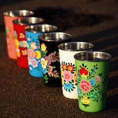 cute little folk art cups.  These would be easy to paint and seal.