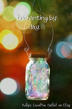 iridescent wrapping paper with a solar light glued to the lid so they sparkle during the day and glow at night. Soooo making a few of these for my yard!!