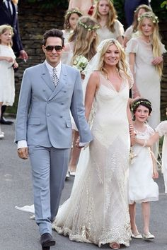 Kate Moss married front man for The Kills Jamie Hince in a John Galliano gown at St Peter's parish church in Southrop in the Cotswolds in July 2011.