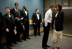 On a chilly freight elevator headed to an Inaugural Ball, the President puts his tuxedo jacket over Michelle's shoulders, Jan. 2009.