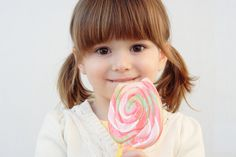 Sweet Fringes Cute Hairstyle with Ponytail and Long Bangs for a Little Girl