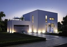 Modern House Style - exterior. garage door. long windows. modern front door. pathway uplighting.