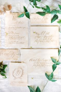 The laurel design, understated calligraphy and antiqued paper sets the tone for the perfect nature-inspired wedding.   - HarpersBAZAAR.com