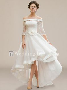 Floral sash around the waist combines the elegance and beauty with Organza high-low Skirt. Completing the look of this dress is a zipper back closure with covered buttons. Via Inweddingdress.com #weddingdresses