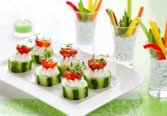 Cucumber appetizer and shot glasses with dip and veggies