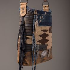 Navajo bucket with indigo patches and sterling conchos