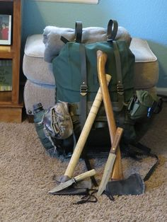 A Swedish 35 liter rucksack from sportsmans guide with a detachable gear belt added. The pack has a steel frame and is made of heavy duty canvas with a rubberized liner.