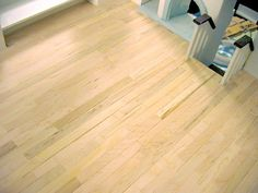 """Popsicle stick """"wood""""  flooring for a dollhouse - describes how to do it, plus photos with floor natural, stained, and painted white."""