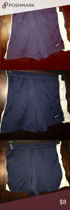 Nike Athletic Shorts Nike athletic shorts, navy with white stripes on sides in great condition size extra small Nike Shorts
